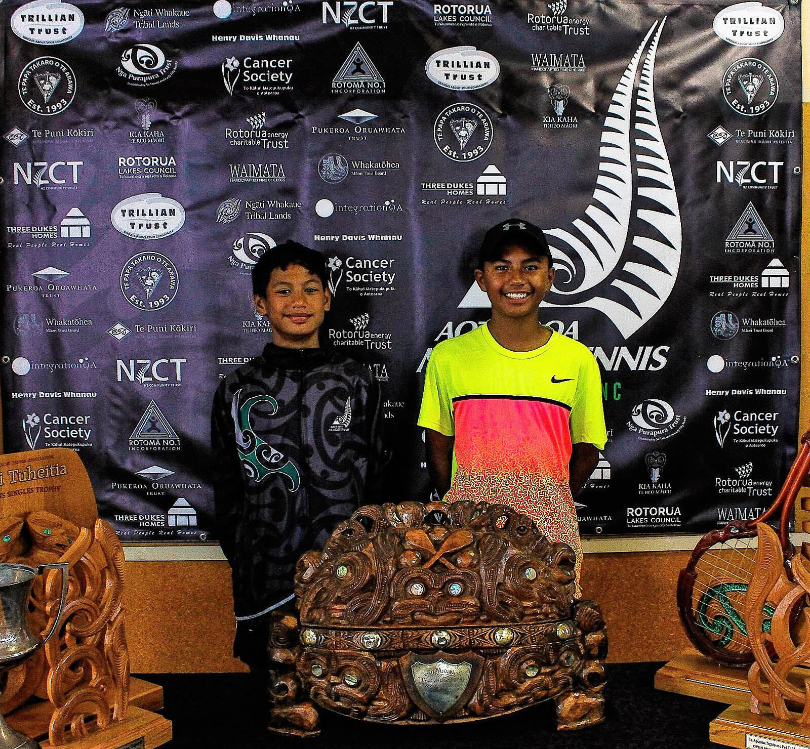 Te Papa Takaro o Te Arawa 14-16 Boys Singles Winner Jeremiah Himiona Teua (next to Boston Danford)